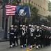 Sailors walk in the Mardi Gras Floral Parade in Mobile, Ala.