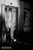 Approaching (wanderandclick) Tags: acros street people streetphotography doorway holiday door flyer shadow graffiti fujifilmxt2 spain silhouette travel longshadow fujifilmacros fujifilmx xf35mmf2rwr madrid contrast europe españa fujifilm comunidaddemadrid es