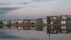 Marceddì (nicolamarongiu) Tags: marceddì case riflessi colori acqua tramonto sunset rosa pink paesaggio landscapes architettura progressione