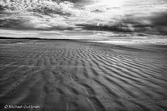 Lines in the Sand (Michael Guttman) Tags: beach newport oregon coast bw blackandwhite monochrome lines patterns sand sky clouds sun footsteps tracks ocean sandpatterns
