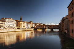 Ponte Vecchio - Firenze (Italy) (Andrea Moscato) Tags: andreamoscato italia toscana tuscany town tower torre tourist fiume river water freshwater acqua riflesso reflection view vivid vista ponte bridge architecture architettura ancient art arco arte artist architectural arno sky cielo city città cityscape blue yellow orange sunset tramonto sunshine building edificio nature natura perspective history historic