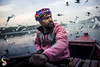 The Bird-Man (Shikher Singh) Tags: gulls yamuna ghat boat boatman row oar river siberiangulls morning scarf pagdi turban shikher'simagery