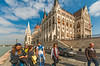 Parliament and Strollers (fotofrysk) Tags: hungarianparliament parliamentbuilding quay tourists riverside idantalljozsefrakpart duna danube river water architecture buildings easterneuropetrip hungary budapest sigmaex1020mmf456dchsm nikond7100201709298476