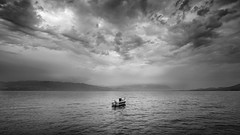 Boat (Adrian Mitu) Tags: greece boat clouds sky water sea drama dramatic outdoors scenic seashore mood moody nature weather mountains gulf
