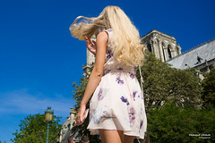 Street - She is like the wind (François Escriva) Tags: paris france woman candid girl olympus omd walking wind hair blond sky blue trees green purple colors photo rue notre dame church
