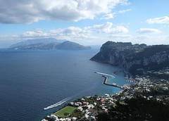 Take me away (halifaxlight) Tags: italy campania capri isleofcapri sea mountains clouds boats jetties houses gardens view blue cliffs