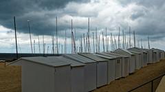 Shades of grey. (Lineahnn) Tags: grey decor monochrome sea sand beach beachhut clouds sky colour scenery coast belgium de haan deserted boat masts