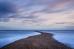 Spit In The Water. (Andy Bracey -) Tags: andybracey bracey andybraceyphotography coast coastal beach pebble shingle spit gravel gravelbar suffolk shinglestreet water spitinthewater landscape seascape tidal clouds sunset colourfulskies littlestopper leefilters longexposure lookingouttosee winter coldtoes tranquil goodforyourwellbeing wellbeing aplacetorepairyourself