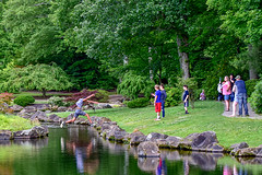 Jumper 3/7 (thatSandygirl) Tags: dawesarboretum newark ohio summer kids teenagers jump leap japanesegarden boyjumping outdoors park water pond green trees nature