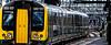 Departing (Peter Leigh50) Tags: emu type class 350 nuneaton station train railway railroad rail platform bright shiny reflection fuji xt10 fujifilm