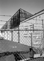 Asbury Ave. (Dalliance with Light (Andy Farmer)) Tags: ilfotechcdeveloper monochrome industrial asburypark nj elmaritm28mm barbedwire bw acros leicacl film fence newjersey unitedstates us leica