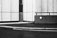 Sims Street (Delay Tactics) Tags: sheffield wall pavement double yellow lines railing black white bw film rule thirds explore