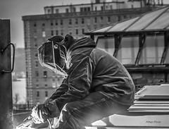 men at work-2 (albyn.davis) Tags: man people worker construction nyc newyorkcity building light welding blackandwhite profile
