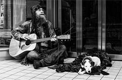 Belfast busker and his loyal friend (teedee.) Tags: belfast busker his loyal friend bw city entertainers music mono pet dog street teedee town shop hall