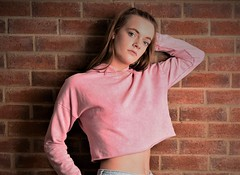 Pretty in pink. (pstone646) Tags: youngwoman younglady portrait pretty people studio blueeyes longhair beauty wall shadows