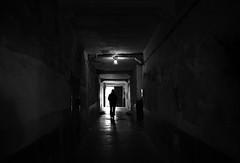 (cherco) Tags: blackandwhite blancoynegro man lonely solitario solitary light abandonado abandoned portal human misterio mistery vanishingpoint urban city silhouette silueta street siniestro terror composition composicion canon ciudad calle black