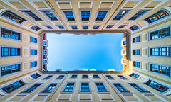 Leipzig Courtyard (laga2001) Tags: building architecture courtyard windows frame sky facade central symmetrical lookingup pov perspective wideangle leipzig cityscape colorful downtown camera cielo colours
