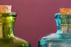 In a bottle (Eduardo_il_Magnifico) Tags: macromonday inabottle cork bottle macro micro closeup colour green blue purple stoppers perfume small two athome nikond750 tamron90mmmacrovcusm tripod