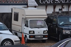 Supercarry Bambi (Sam Tait) Tags: suzuki supercarry super carry white 10 petrol camper van camping 1995 retro rare bedford bambi midi mini sooty lowestoft england range rover golf used car sales mobile home rv