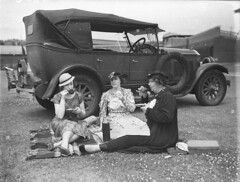 Three women cricket spectators picnicking beside a 1928 Buick during a 2nd XI cricket match between NSW and Victoria at the Sydney Cricket Ground, 27 December 1934, by Sam Hood. (State Library of New South Wales collection) Tags: statelibraryofnewsouthwales buick spectators cricket