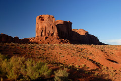 Look At That Rock (rdodson76) Tags: monumentvalley famousdestinations travel tourism tour tourist places landscape rocks mountains desert redsoil earth arid climatechange beauty pretty plants scrub western vacation roadtrip navajo tribal park summer day nopeople tranquility utah postcard pamphlet brochure view scenic indian green red adventure escape outside outdoors recreation hiking nature serenity arizona sky rock