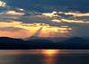 Champlain Sunset (lindamary22) Tags: lakechamplain vermont newyork adirondack mountain sunset clouds crepuscular rays sunbeams reflection red orange glow