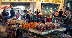 Another day, another long night out in the street (gunman47) Tags: 2017 50mm asia bangkok chinatown christmas december east road siam south thai thailand yaowarat charm customer f14 for fruits night people photography pomegranate street urban vendor waiting krungthepmahanakhon