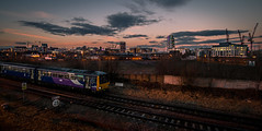 Pacer Sunset (Andrew Shenton) Tags: holbeck leeds engine shed junction dusk night sky 144015 pacer class144 2f25 goole city railway train