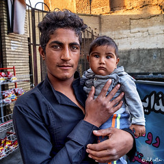Baloch man and child (isitaboutabicycle) Tags: baluchi baluch baloch بلوچ iran kerman man eyes manandchild fatherandson portrait streetportrait child xt10 father dad son پسر پدر