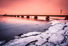 Ice by the beach (Maria Eklind) Tags: ribersborg sunset nature water spegling city outdoor weather ribban beach malmö strand reflection bridge bro sky sunlight winter ribersborgsstranden sweden ice skånelän sverige se