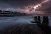 Cracked Open (hammermad) Tags: sunrise sea seascape clouds drama groin seaside water pier sky ocean light