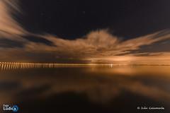 Limbus (Iván Calamonte) Tags: lisboa lisbon portugal europe night clouds sky nightscape skyscape water river sea ocean fotoludica light bridge vasco gama stars
