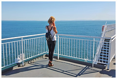 Ferry Call (HereInVancouver) Tags: youngwoman call cellphone ocean pacific georgiastrait bcferry deck atsea outdoors water horizon backpack blonde alone solitary candid summer canong15 thingstodobythewater
