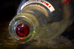 Marble in a Bottle (brucetopher) Tags: macromondays inabottle bottle soda twinlights jimmybottle returnable marble red glass rockport capeann historical history neck round circle circles concentric