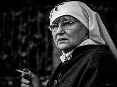 think about it [out series] (paolo paccagnella) Tags: redcross bn best bw blackandwhite cigar smoke portrait eos5dm3 eyes ritratto territorio think yahoo:yourpictures=monochrome italy idea old photo paolo paccagnella padova ambiente activity nun nurse