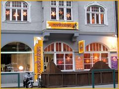 Innsbruck, Austria (PDX Bailey) Tags: austria innsbruck europe food restaurant indian cuisine gold yellow orange motor bike street people window star madhuban arch greeter waiter owner