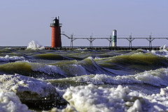 Hints of Spring (Tom Gill.) Tags: lighthouse lake lakemichigan greatlake waves ice pier michigan southhaven