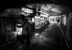 Tokyo 07 (arsamie) Tags: tokyo japan bnw bw black white umbrella man blur street alley downtown city asia center life people sad sadness