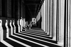 Light and shade (Phototravelography) Tags: bw berlin deutschland germany museum museumsinsel neuesmuseum art black columns culture dark light lines monochrome people shade shadow stripes sun architecture