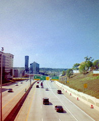 Interstate 196 (Inland Oceans) Tags: grand rapids michigan lomography lomo dianamini skyline interstate 196 freeway highway