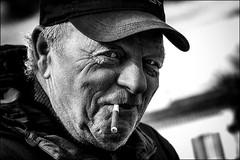 Le pêcheur espiègle / The impish fisherman (vedebe) Tags: port portraits ports portrait noiretblanc netb nb bw monochrome homme humain human people pêche pêcheur rue street ville city urbain urban