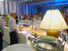 Feeding time (Roving I) Tags: guests buffets conventioncentres catering food chefs plasticgloves plates lamps events ariyana furama resorts danang vietnam