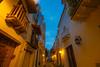 Colonial Balconies, Cartagena Colombia (AdamCohn) Tags: kmtoin adamcohn cartagena colombia architecture bluehour bluesky colonial colonialarchitecture geo:lat=10424681 geo:lon=75549680 geotagged street streets wwwadamcohncom bolívar