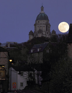 Full moon rising behind Ashton Memorial, Lancaster, UK