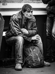 Packed and Leaving (Maarten Baars) Tags: unhappy unposed candid people interestingpeople panasonicgx80 panasonic45175mm blackandwhite streetshots streetphotography story streetphoto streettogs urbanphotography monochrome microfourthirds mirrorless micro43 streetview