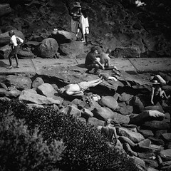 Eat your heart out, Mr DeRucci (Geoff Hyde) Tags: rocks people candid streetphotography weird crazy sunbathing relaxation blackandwhite