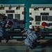 Sailors perform maintenance on aircraft carrier.