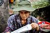 Leggendo al mercato (Valdy71) Tags: vietnam woman donna mercato market valdy nikon hanoi travel portrait