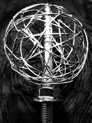 paperclip energy ball (AlexKapunkt) Tags: macro mondays fasteners hmm macromondays paperclip screw energy bw büroklammer schraube