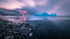 Sunset at the Glacier Lagoon - Iceland - Seascape photography (Giuseppe Milo (www.pixael.com)) Tags: photo landscape sunset nature outdoor clouds longexposure iceland travel sea photography iceberg sky seascape rocks europe geotagged ice easternregion is onsale